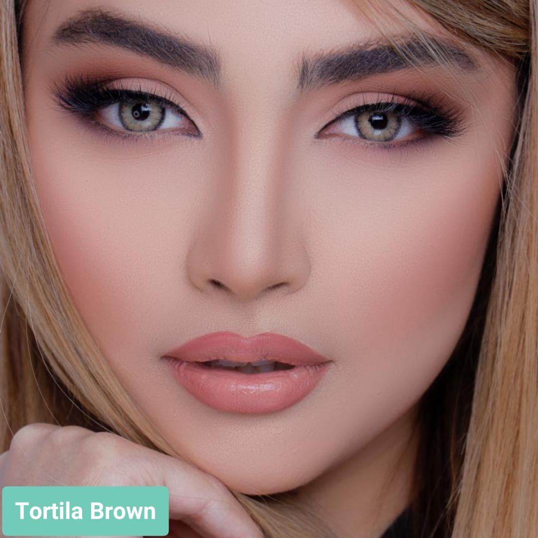 فروش لنز Tortila Brown (عسلی طوسی دوردار)  برند لولیتا بهمراه قیمت امروز لنز رنگی  و قیمت امروز لنز طبی